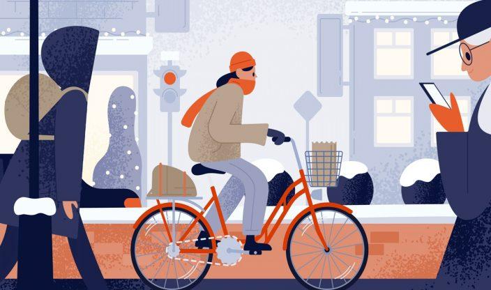 Frau fährt im Winter Rad