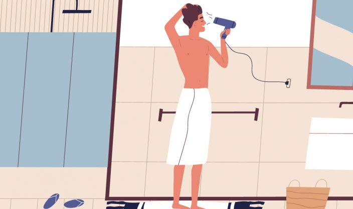 Mann föhnt sich die Haare