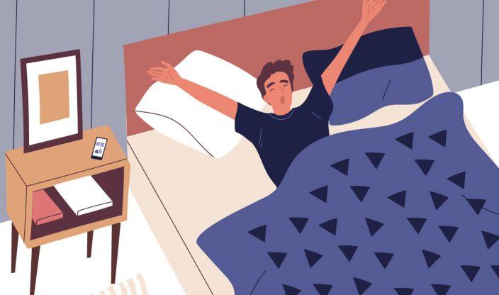 Mann liegt im Bett