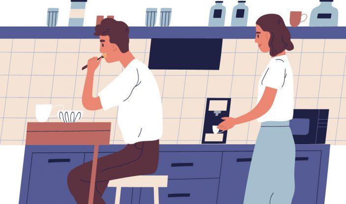 Mann isst am Küchentisch