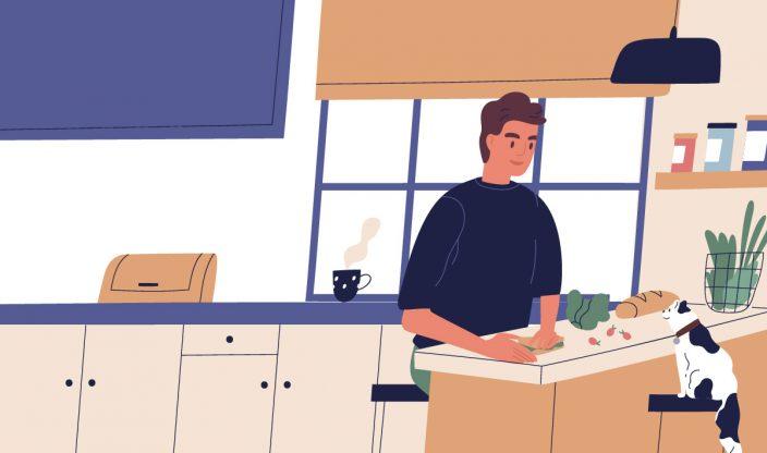 Mann sitzt am Tisch mit Katze