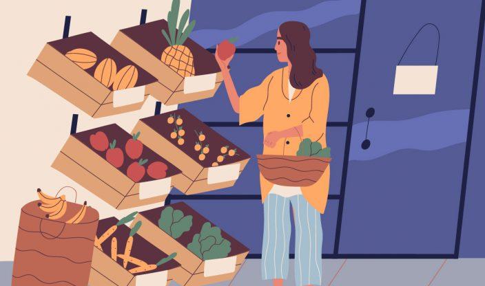 Frau kauft Obst ein